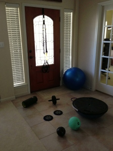 Some of my exercise equipment: stability ball, foam roller, medicine ball, ab wheel, BOSU, TRX Bands