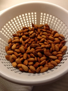 Straining the soaked, raw almonds